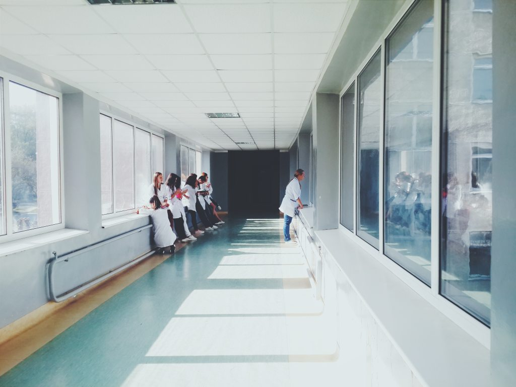 Healthcare workers in the hallway of a hospital.