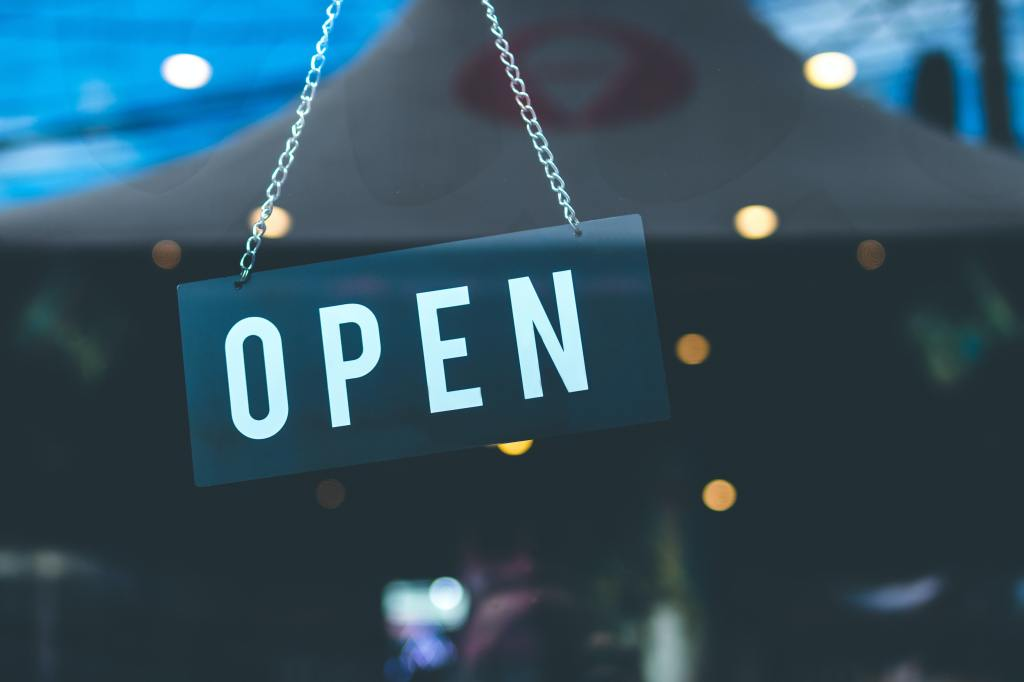 """A store sign that says """"open."""""""