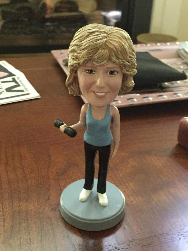 Bobblehead on Sandy's desk.